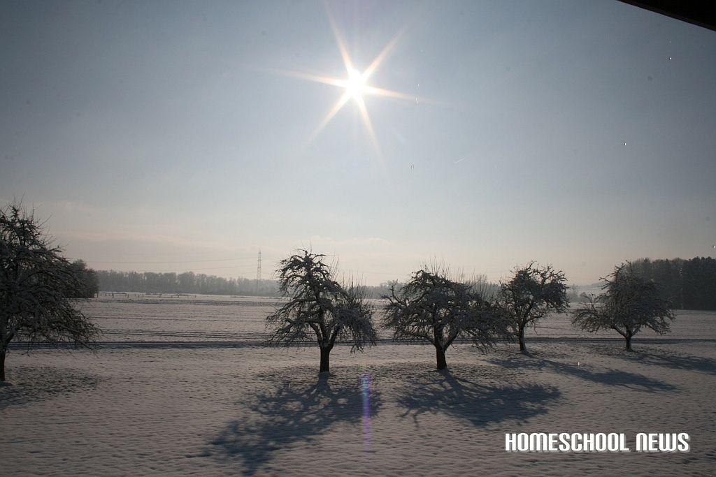 Sonne über Schneelandschaft